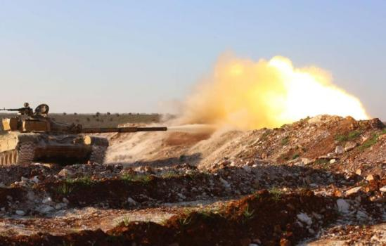 A tank confiscated by rebel fighters fires at a pro-government position near the Syrian city of Hama, on February 19, 2014. (Photo: AFP- Abu Hadi al-Hamwi)